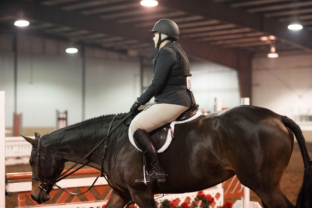 Hunter rider at a horse show, to represent the Meet Me in St. Louis IV horse show.